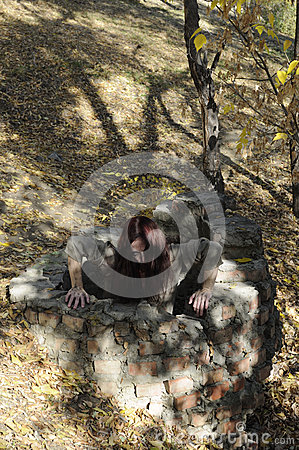 Horror woman in well