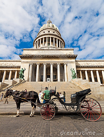 Horse carriages waiting for tourists in Havana Editorial Image