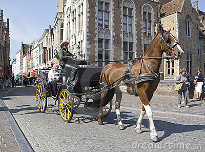 Horse-drawn carriage in Bruges Editorial Photography