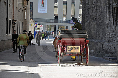 Horse driven carriage with tourists in Salzburg Editorial Photo