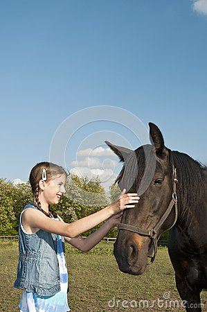 Horse on the farm with girl portrait