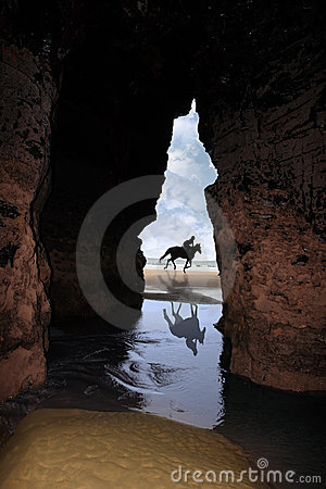 Free Horse Galloping Past Cave Stock Photography - 15897582