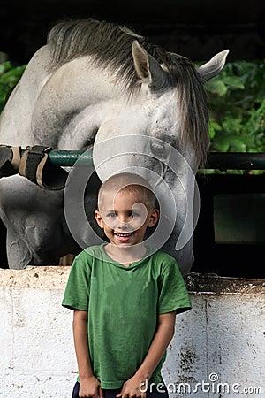 Horse hugging a boy