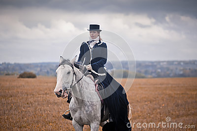 Horse-hunting with ladies in riding habit Editorial Stock Image
