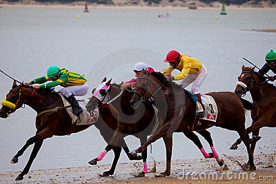 Horse race on Sanlucar of Barrameda, Spain Editorial Photo