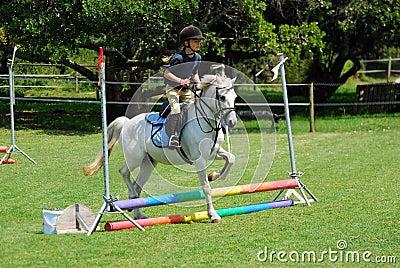 Horse riding little girl