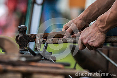 Horse shoe being crafted by blacksmith/farrier