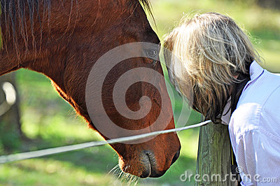 Horse whisperer - soft dreamy portrait woman & pet