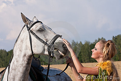 Horse and woman face to face