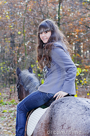 On horseback in the forest