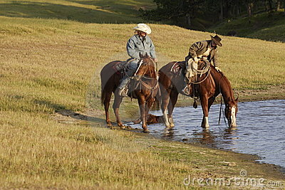 Horseback Riders at Water Hole