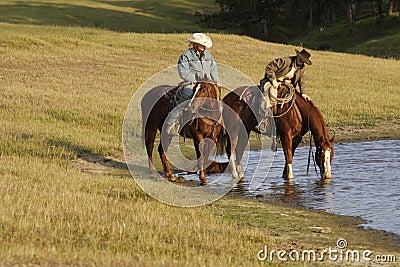 Horseback Riders at Water Hole