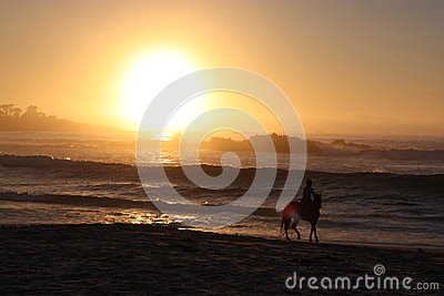 Horseback riding and beach sunset