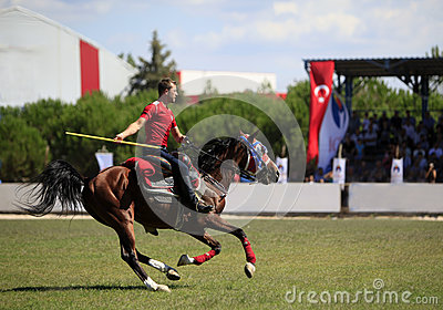 Horseman competition with javelin Editorial Photo