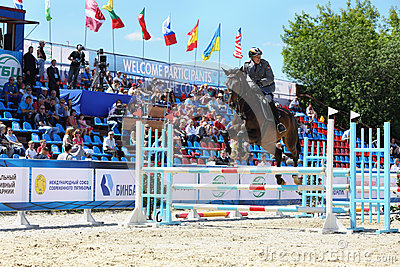 Horseman participate in competitions on tournament on modern pentathlon Editorial Stock Photo
