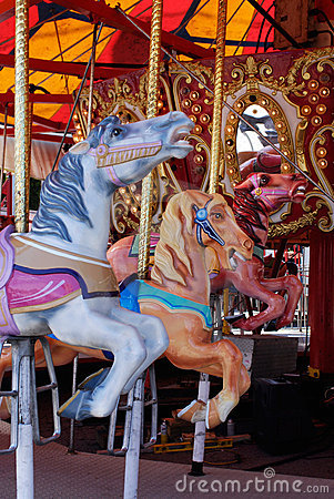 Horses in carousel, merry-go-round at carnival