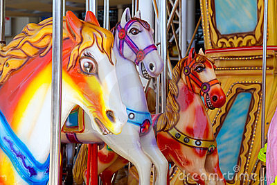 Horses in merry go round fairground