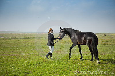 Horsewoman trains the horse