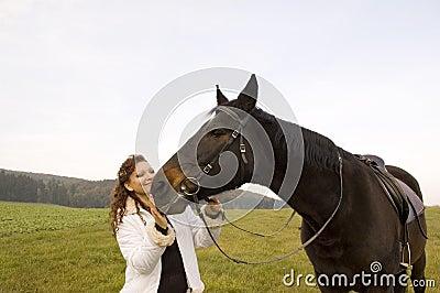 Horsewoman und Pferd.