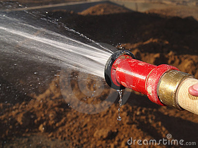 Hose Spraying Water on Ground - Horizontal