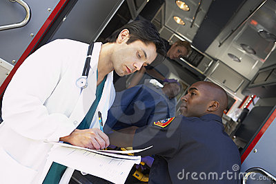 Hospital doctor taking notes paramedics