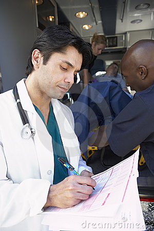 Hospital doctor taking notes paramedics