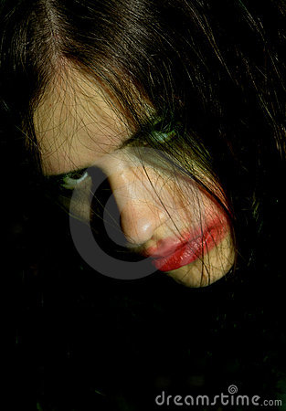 Hostile look of a young woman with psychical problems