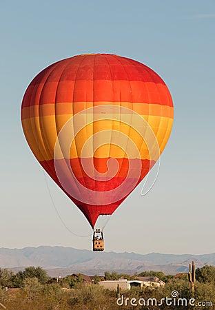 Free Hot Air Balloon Over North Phoenix Desert Royalty Free Stock Photos - 60741578