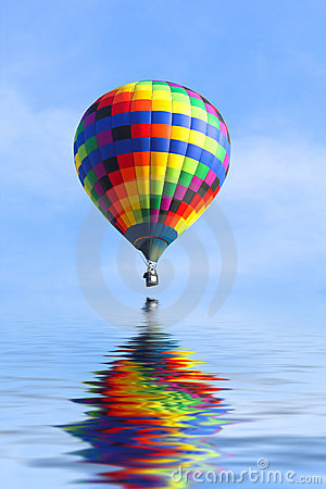 Hot Air Balloon Over Water Royalty Free Stock Image