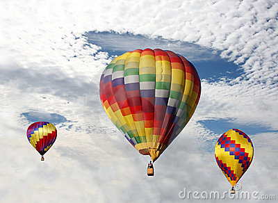 Hot Air Balloons Desending Thru the Clouds,