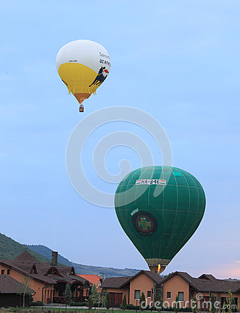 Hot air balloons landing on courtyards Editorial Photo