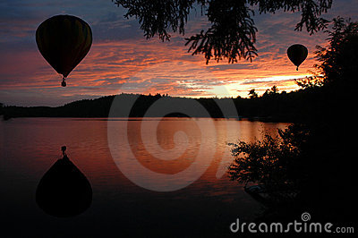 Hot-Air Balloons over Water at Sunset Sunrise