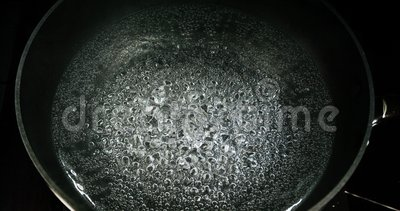 Hot boiling water in a saucepan, slow motion 4K stock video footage