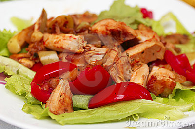 Hot Chicken salad with lettuce, apples and tomatoes