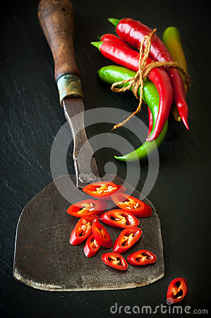 Free Hot Chili And Antique Knife For Chopping Herbs Royalty Free Stock Image - 34192566