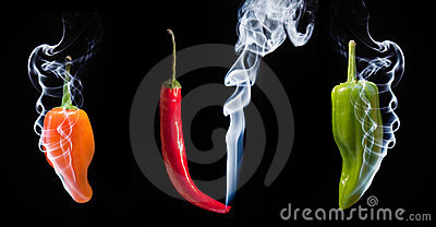 Hot chilli peppers with smoke coming out of end