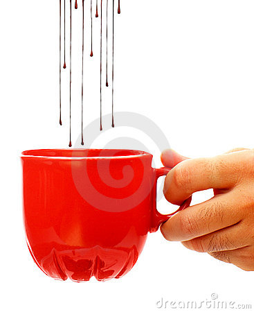 Hot chocolate dropping into coffee cup