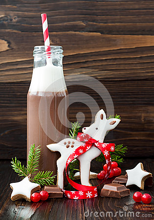 Free Hot Chocolate With Whipped Cream In Old-fashioned Retro Bottles With Red Striped Straws. Christmas Holiday Drink And Gingerbread B Stock Images - 69883604