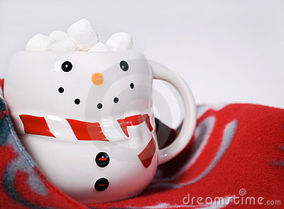 Hot cocoa with marshmallows in snowman mug