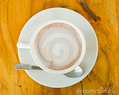 Hot coffee in cup with plate
