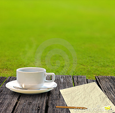 Hot coffee and letter paper on the wooden table