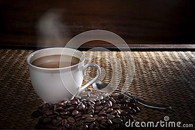 Hot coffee and roast bean on wood
