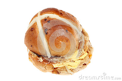 Buttered hot cross bun isolated against white.