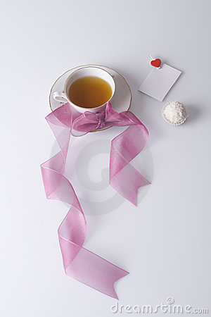 Hot cup of tea with love note and cookie