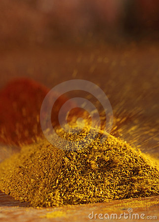 Hot curry powder in a pile flying away