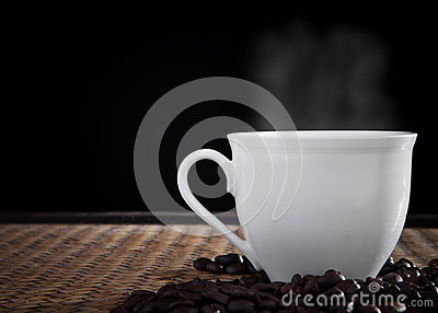 Hot fresh coffee with smoke on cup