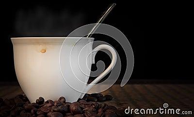 Hot fresh coffee with smoke on cup