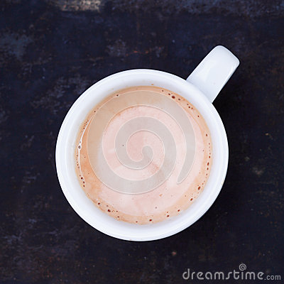 Hot frothy cup of cappuccino or cafe au lait