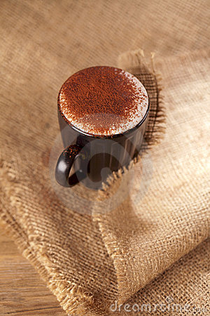Hot frothy drink cappuccino chocolate dusted