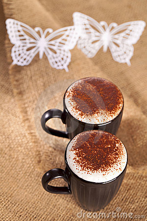 Hot frothy drink cappuccino chokolate dusted